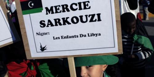1507176_3_8dfc_une-petite-fille-libyenne-tient-une-pancarte_68a9f6f13709e00320d9f15f508a7681.jpg